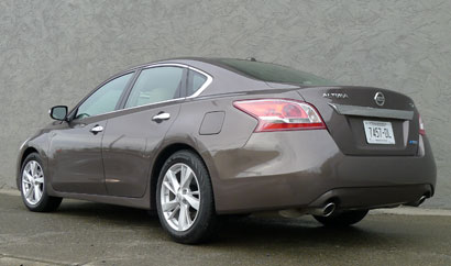 A three-quarter rear view of a 2013 Nissan Altima 2.5 SV