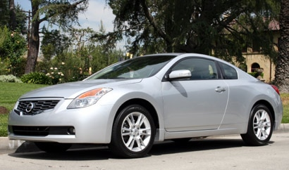 A three-quarter front view of a gray 2008 Nissan Altima Coupe 3.5 SE in Los Angeles