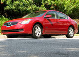 A three-quarter front view of a red 2009 Nissan Altima Hybrid