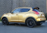 A three-quarter rear view of a 2013 Nissan Juke SL