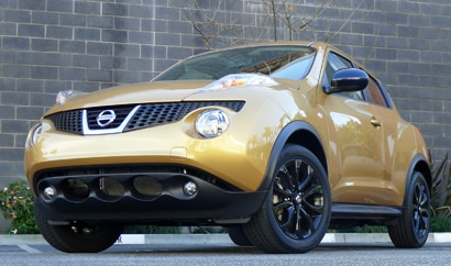 A three-quarter front view of a 2013 Nissan Juke SL AWD CVT