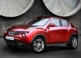 A three-quarter front view of a red 2011 Nissan Juke