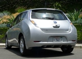 A three-quarter rear view of a 2011 Nissan Leaf