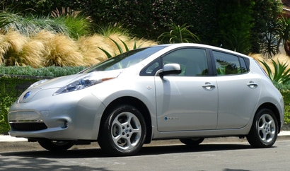 A three-quarter front view of a 2011 Nissan Leaf
