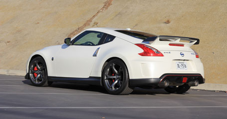 A three-quarter rear view of a 2014 Nissan 370Z Nismo, one of our Top 10 Sports Coupes