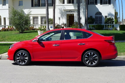 A side view of a 2016 Nissan Sentra SR Sedan shown in Red Alert