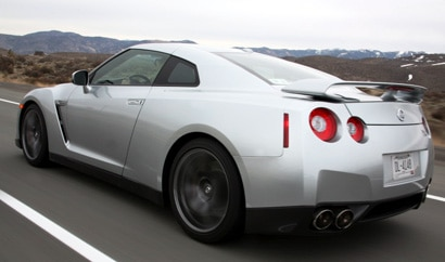 A three-quarter rear view of a silver 2009 Nissan GT-R on the track at the Reno-Fernley Raceway in Nevada