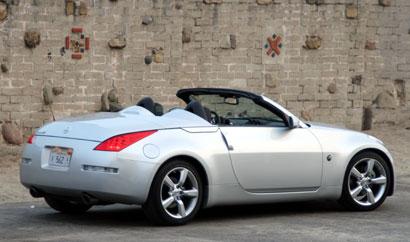 A three-quarter rear view of a gray 2008 Nissan 350Z Roadster Touring
