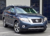 A three-quarter front view of a 2013 Nissan Pathfinder Platinum 4x4