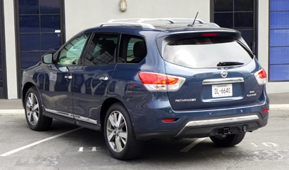 A three-quarter rear view of a 2013 Nissan Pathfinder Platinum 4x4