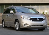 A three-quarter front view of a 2013 Nissan Quest 3.5 LE