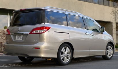 A three-quarter rear view of a 2013 Nissan Quest 3.5 LE