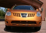 A front view of an orange 2008 Nissan Rogue SL 2WD