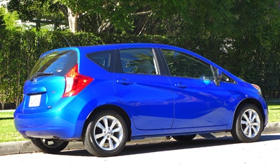 A three-quarter rear view of a 2014 Nissan Versa Note