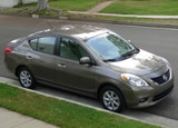 A three-quarter front view of a 2012 Nissan Versa 1.6 SL Sedan