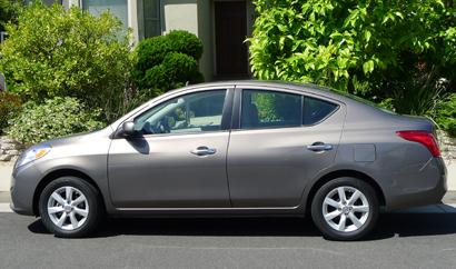 A side view of a 2012 Nissan Versa 1.6 SL Sedan
