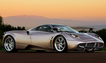A three-quarter front view of a silver Pagani Huayra