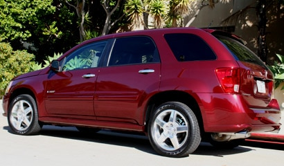 A three-quarter rear view of a red 2008 Pontiac Torrent