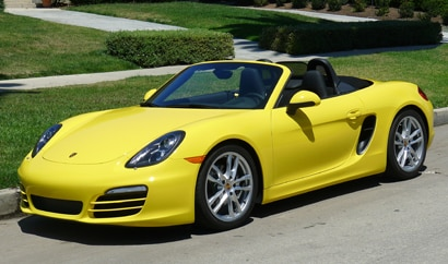 A three-quarter front view of a 2014 Porsche Boxster, one of GAYOT's Top 10 Fun-to-Drive Cars 2014