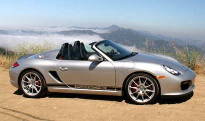A side view of a silver 2011 Porsche Boxster Spyder