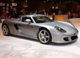 A three-quarter front view of a silver Porsche Carrera GT