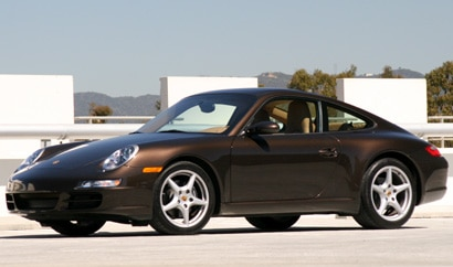 A three-quarter front view of a black 2008 Porsche 911 Carrera