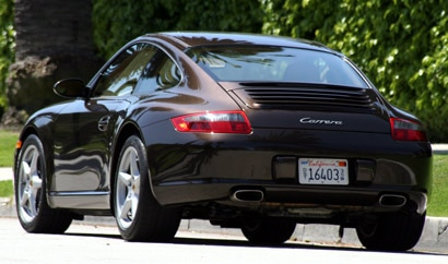 A three-quarter rear view of a black 2008 Porsche 911 Carrera in Los Angeles