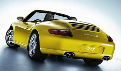 A three-quarter rear view of a yellow 2008 Porsche 911 Carrera S Cabriolet