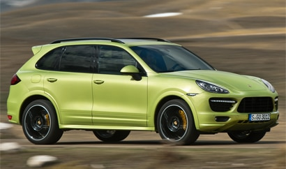 A three-quarter front view of a 2013 Porsche Cayenne GTS in action
