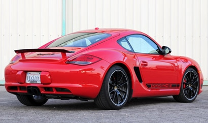 A three-quarter rear view of a red 2012 Porsche Cayman R
