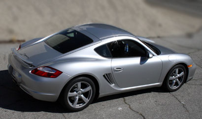 A three-quarter rear view of a silver 2007 Porsche Cayman