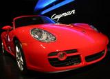 A three-quarter front view of a red 2007 Porsche Cayman