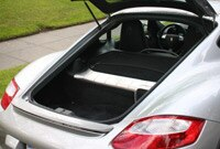 Porsche Cayman features a hatchback trunk