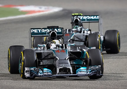 Lewis Hamilton and Nico Rosberg of Mercedes AMG Petronas at the 2014 Formula 1 Gulf Air Bahrain Grand Prix