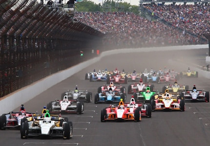 Racecars duel it out for first place at the 99th edition of the Indianapolis 500 at Speedway, Indiana
