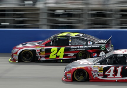 Kurt Busch and Jeff Gordon vie for position at the 2014 NASCAR Sprint Cup Series Auto Club 400 at Auto Club Speedway in Fontana, California (Photo credit: Jenny Markland/ NASCAR via Getty Images)
