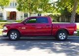 A side view of a 2013 Ram Outdoorsman Crew Cab 4x4