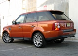 A three-quarter rear view of a 2006 Range Rover Sport Supercharged