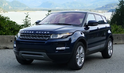 A three-quarter rear view of a blue 2012 Range Rover Evoque 5-Door