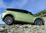 A side view of a 2012 Range Rover Evoque Coupe in the mountains above Vancouver, Canada
