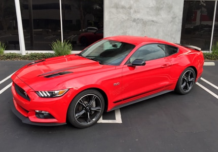 A three-quarter front view of a 2016 Ford Mustang GT, one of GAYOT's Top 10 Romantic Cars
