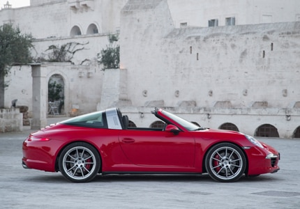 A side view of the 2016 Porsche 911 Targa 4 in a romantic red tint