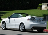 A three-quarter rear view of a white 2009 Saab 9-3 Aero Convertible