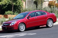 A three-quarter front view of a red 2007 Saturn Aura XR