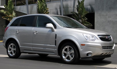A three-quarter front view of a gray 2008 Saturn Vue Green Line Hybrid
