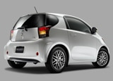 A three-quarter rear view of a white 2011 Scion iQ