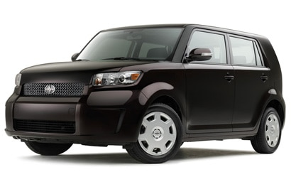 A three-quarter front view of a black 2008 Scion xB