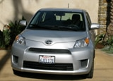 A front view of a silver 2010 Scion xD