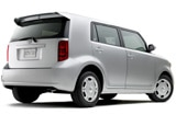 A three-quarter rear view of a gray 2008 Scion xB