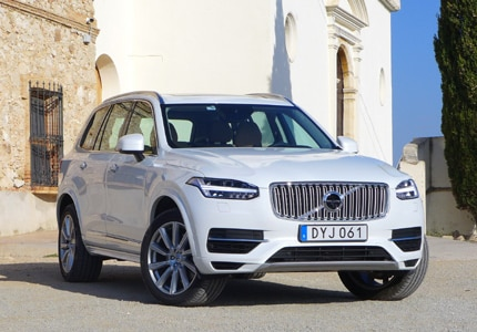A three-quarter front view of a 2016 Volvo XC90 T8 Plug-In Hybrid SUV